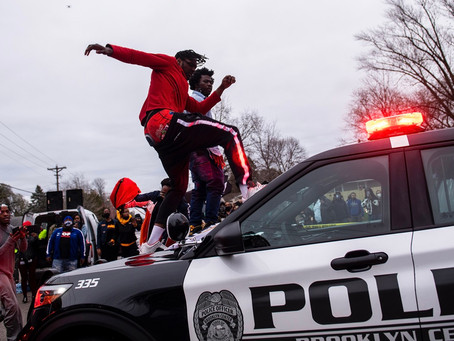 Protestors Seen Jumping on Police Cars, Looting After Officer-Involved Shooting in Minnesota