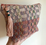'Woven in Bricks' - Verbena  Luxurious clutch/pouch bag handwoven in a limited-edition design.  Hand finished with a tassel trim.  Backed and fully lined a with premium cotton linen fabric.  £44.00