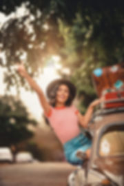 woman-smiling-sitting-on-car-window-2952
