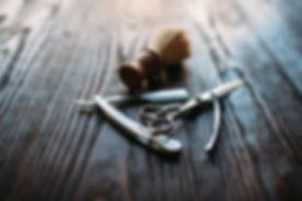 Shaving and barber equipment on wooden background.jpg