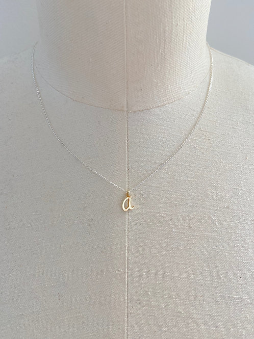 A Small Cursive Gold Charm Sterling Silver Chain Necklace