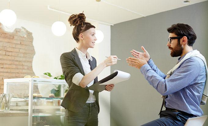 Business man and woman debating terms.