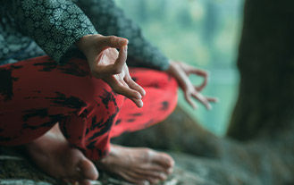 Woman Meditating sat down