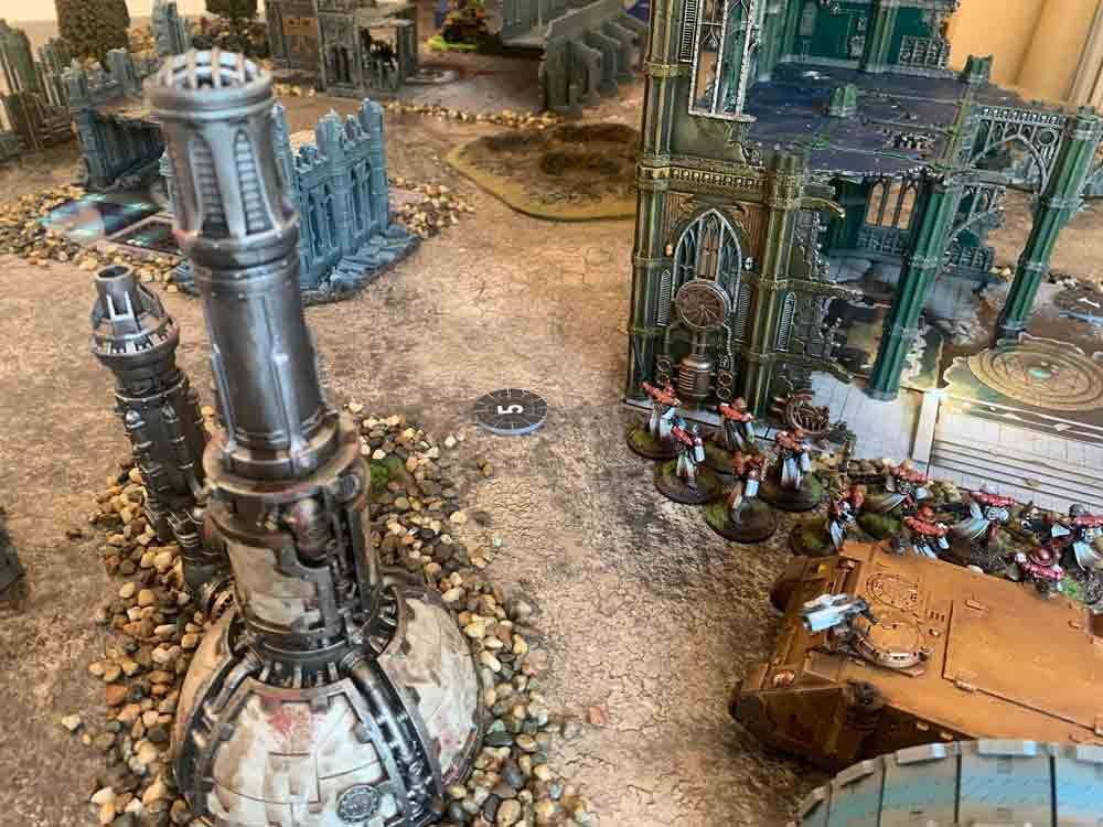 Sisters of battle moving through some Warhammer 40k terrain