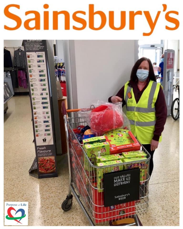 Sainsburys giving a donation to POL Foodbank