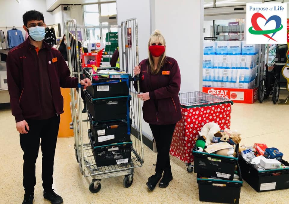 Sainsburys donating food to Purpose of Life Charity.