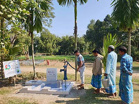People queuing to use a water well in India constructed by Purpose of Life