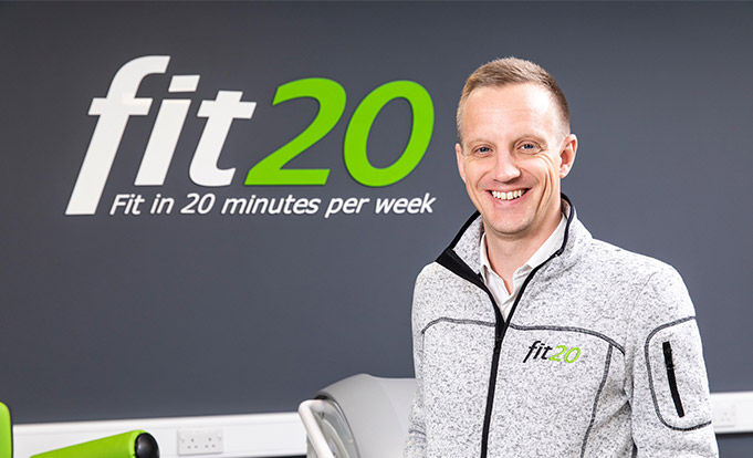 Matt Appleby from Fit20 standing in front of his equipment