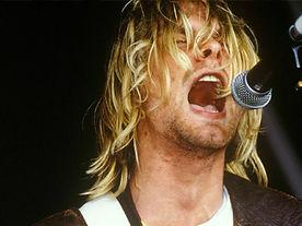 Kurt Cobain singing into a microphone