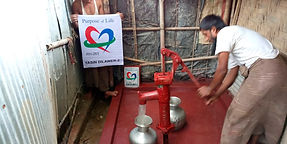 Person pumping water from new Water Well installation in Rohingya