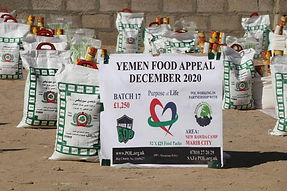 Pupose of life banner in front of food packages delivered in Yemen
