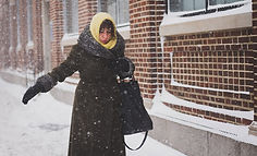 Woman trying to walk in Icy and snowy conditions