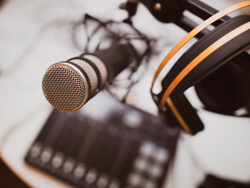 top down view of a microphone being used for podcasting