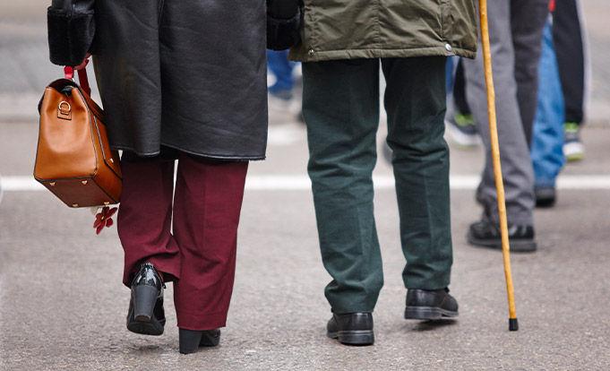 Legs of Old People walking in the street