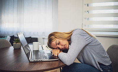Blond Woman taking a Nap on her Desk