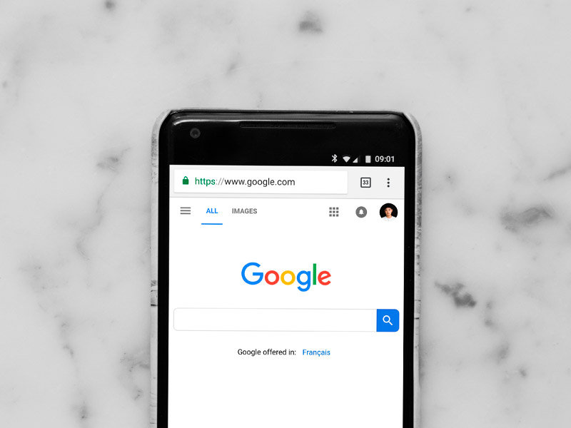 Google search bar on mobile phone with marble background