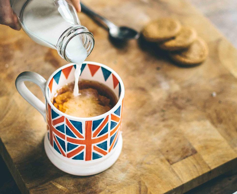 Milk into a cup of tea