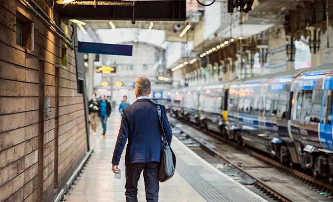 Man walking towards a Train going to work