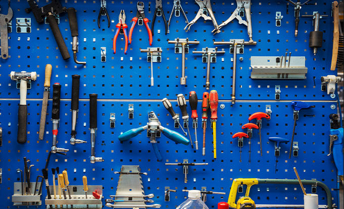 Various tools on a blue backboard
