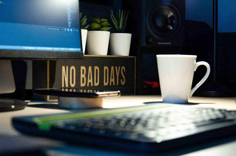 Keyboard with Mug of coffee in focuss