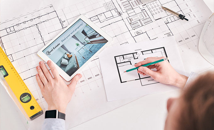 Person producting hand drawn floor plans