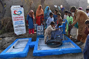 People using a newly constructed water well installed by Purpose of Life Charity