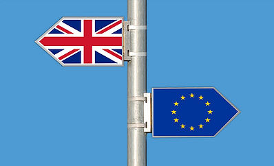 Signpost showing Union Jack flag and European union flag