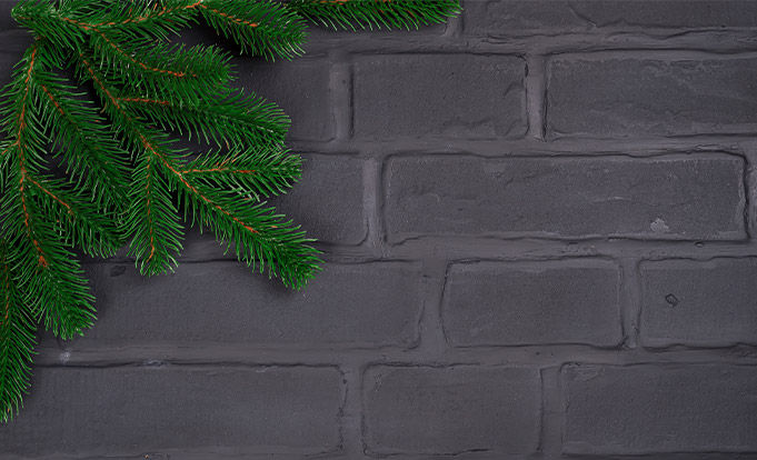 grey bricks with Christmas tree foliage