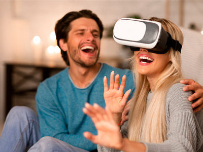young couple enjoyinh a VR headset