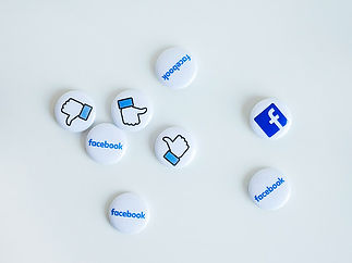 collection of facebook icons in blue as badges on white backgrounds