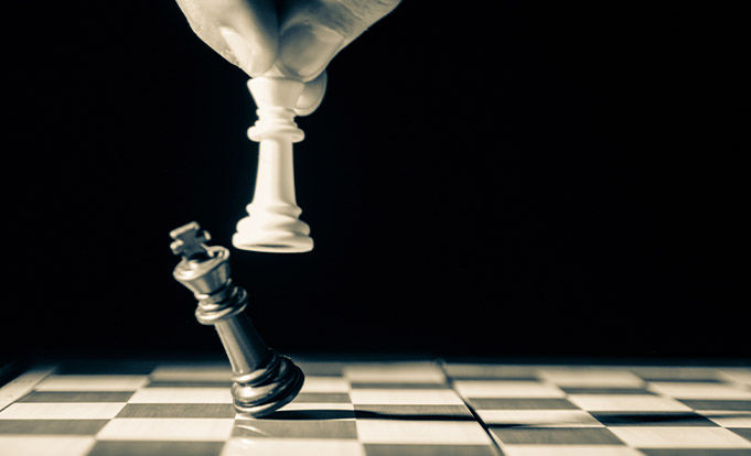 Two chess pieces finishing a game
