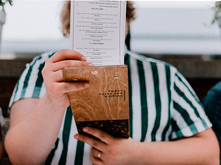 Man holding Menu in front of his face
