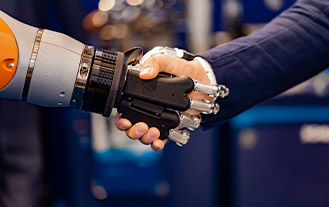 man shaking the hand of a cyborg