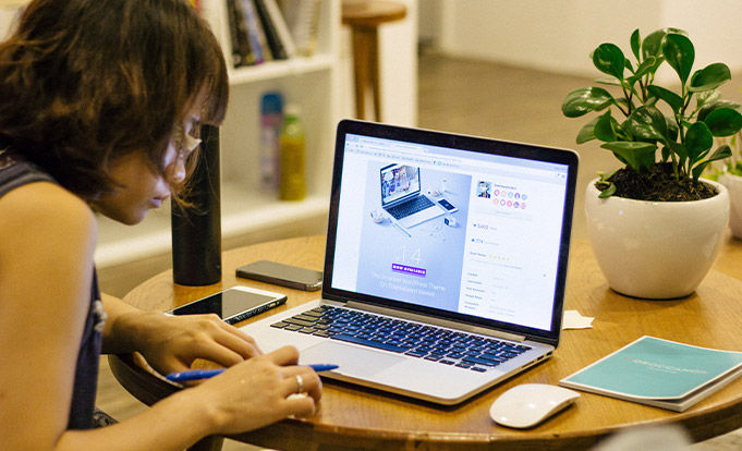Woman working on laptop from desk