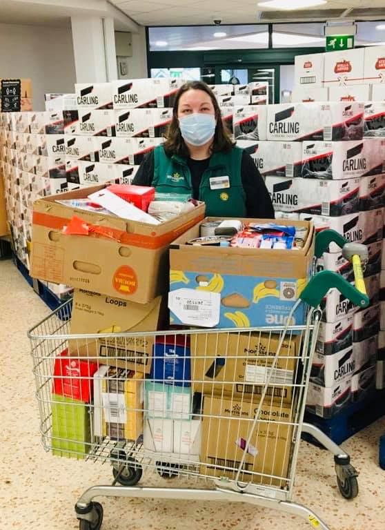 Wendy at Morrisons giving out a charity donation