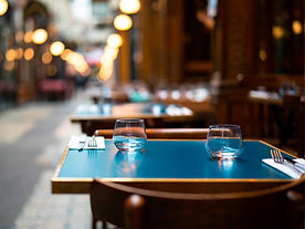 Deserted restaurant table with place settings set up
