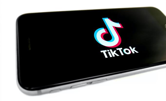 Phone displaying Tik Toc Logo