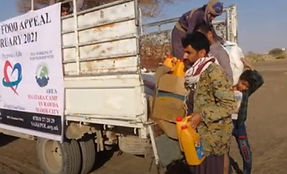 Man collecting food parcel from truck, sponsored by Purpose of Life