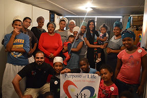 Purpose of Life celebrating donations with children in South Africa