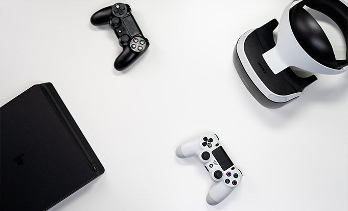 Playstation 4 with two controllers and headset set on a white background