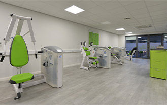 Fit20 Gym Equipment next to a white wall