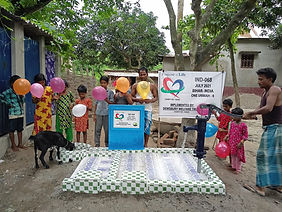 People gathered around a water well newly built by Purpose of Life charity