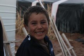 Child Smiling in Jordan