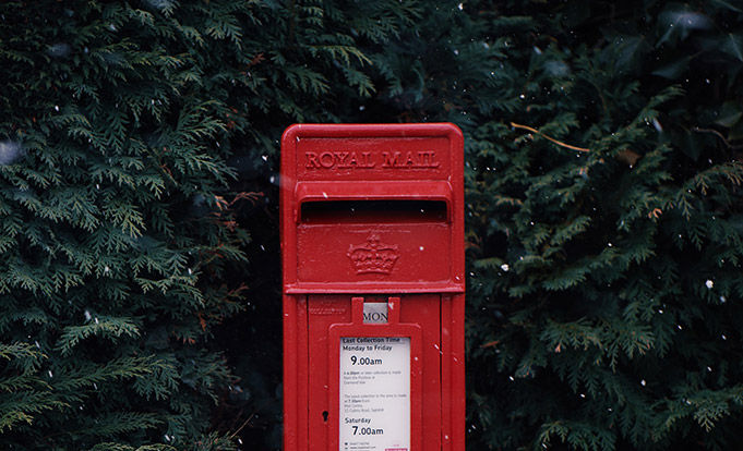 Royal mail post box in trees