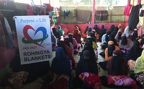 Group shot of Muslim Women receiving blankets