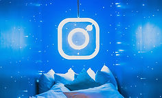 Instagram logo made out of blue neon lights