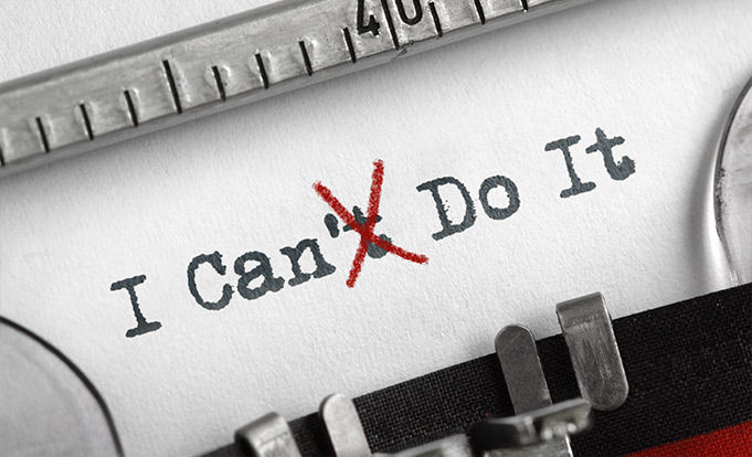 Typewriter paper with I Can Do It written across the front