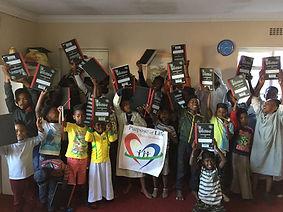 Children getting donated school books