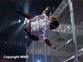 Mick Foley falling from a Hell in the Cell cage structure in 1998
