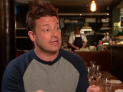 tv cook jamie oliver looking at an interviewer off camera